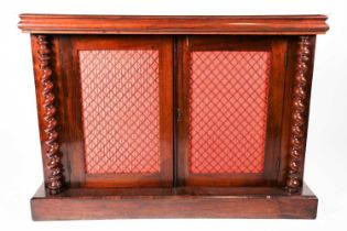 A Victorian marble-topped rosewood two-door chiffonier, with ogee moulded and each door with silk
