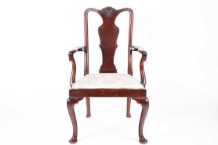 A George II style mahogany open arm carver chair with carved vase splat, crook arms above a drop