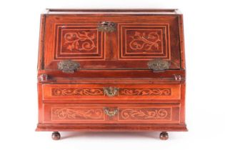 An early 19th German tabletop walnut and marquetry fall front writing bureau, Fitted two long frieze