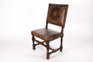"""A late 17th century walnut """"Farthingale"""" type side chair with decorative studded stuff over """""""