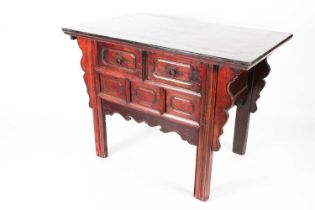A 20th century stained and lacquered elm altar table with two frieze drawers supported on shaped