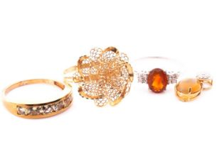 A 9ct yellow gold and pale yellow gemstone ring, channel-set with round-cut stones, size V, together