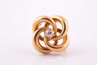 A lovers knot brooch, in yellow metal with central claw set old cut diamond, 4.9 mm diameter,