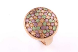 A multi gem-set dress ring; the domed cluster set with multi-coloured pink, amber and green gem