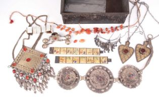 A small quantity of various white metal items of jewellery, of Eastern origin, including two painted