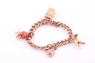 A 9ct rose gold curb-lik charm bracelet, with heart-shaped locket clasp, suspended with a yellow