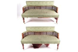 A pair of French Empire style two-seat stained wood sofas, 20th century, with gilt metal mounts