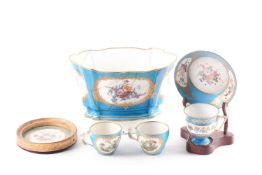 A collection of 18th century and later Sevres Bleu Celeste, comprising a cabinet cup and saucer, two