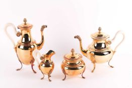 An early 20th century French Empire style, Continental (800) silver gilt four-piece tea set. The set
