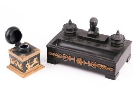 A late 19th century ebonised metalware desk stand, in the French Empire style with a bust of