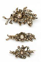 Drie zilveren en gouden takbroches, 19e eeuw/begin 20e eeuw,