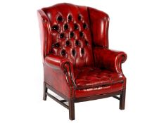 Leather wing chair with red leather