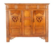 Antique oak cabinet with richly carved décor