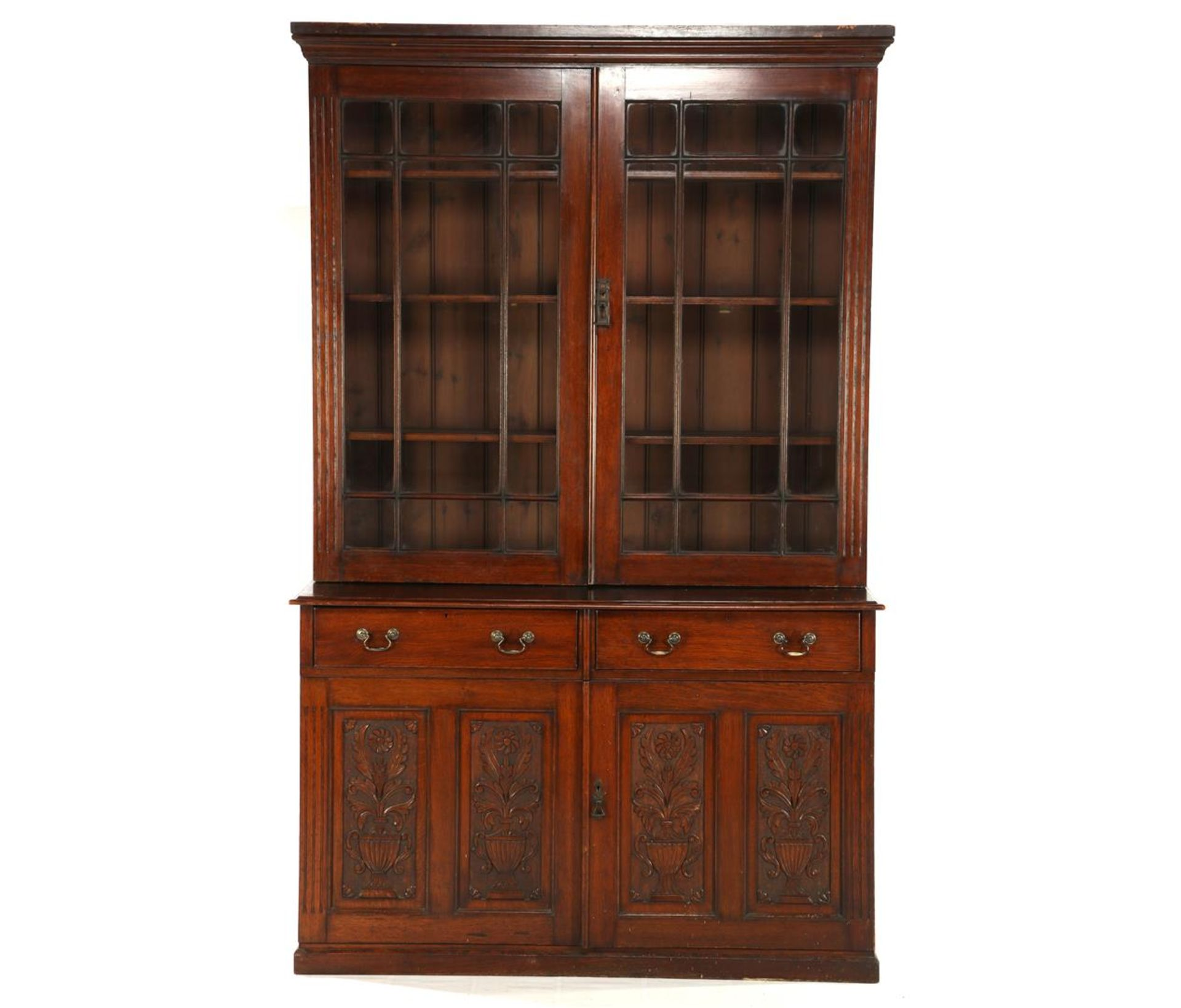 2-part oak sideboard with carved decor on the doors