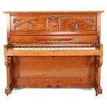 Steinmetz piano in oak cabinet with