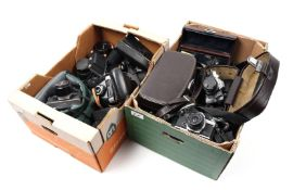 2 boxes of various analog cameras and lenses