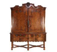 Burr walnut veneer on oak cross legged cabinet