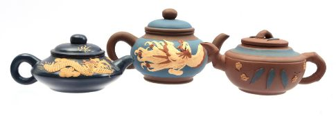 3 earthenware Yixing tea pots with blue decor
