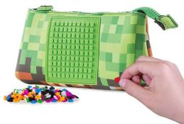 X10 PIXEL CREW CREATIVE LARGE GREEN POUCH. TOTAL RRP £140