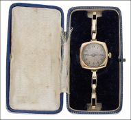 An early 20th century 15ct gold lady's wristwatch by Rolex, the circular engine-turned dial with