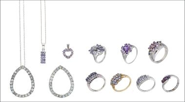 A small collection of gem-set jewellery, comprising a domed gem-set cluster ring stamped '14K', four