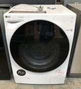 LG WASHING MACHINE - FH4GBCS2 / CONDITION REPORT: UNTESTED CUSTOMER RETURN. USED. COSMETIC WEAR