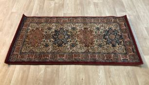 DREWERY SUPREME TUFTED WOOL RED RUG / SIZE: 70 X 140CM BY ROSALIND WHEELER