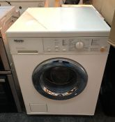 MIELE WASHING MACHINE / CONDITION REPORT: UNTESTED CUSTOMER RETURN. DOOR DOES NOT APPEAR TO OPEN,