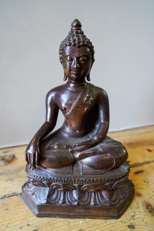 BRONZE FIGURE OF A SEATED BUDDHA SINO-TIBETAN, 20TH CENTURY 37cm high