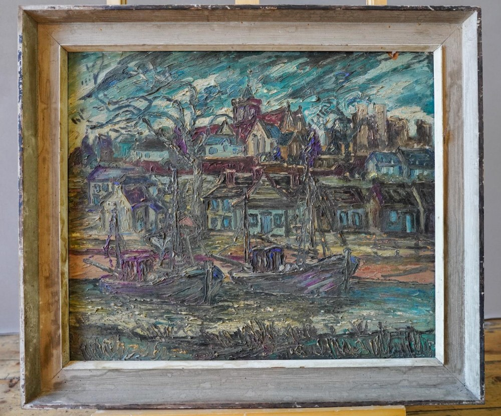 GEORGE HANN (1900-1979) BOATS IN A FISHING VILLAGE oil on board, signed lower right, framed 54cm hig