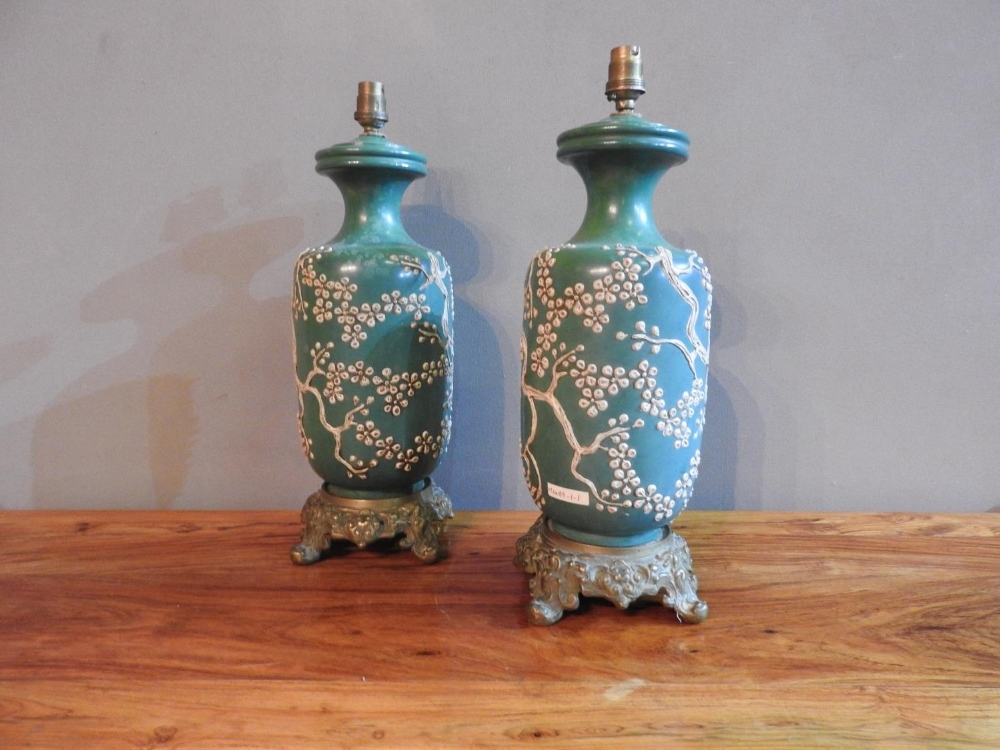 A PAIR OF 19th CENTURY CHINESE GREEN GLAZED TABLE LAMPS EMBOSSED WITH BLOSSOM PATTERN ON ORNATE BRAS - Image 3 of 3