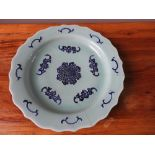 CELADON AND UNDERGLAZE BLUE 'BATS AND RUYI' DISH QING DYNASTY the barbed dish decorated with bands o