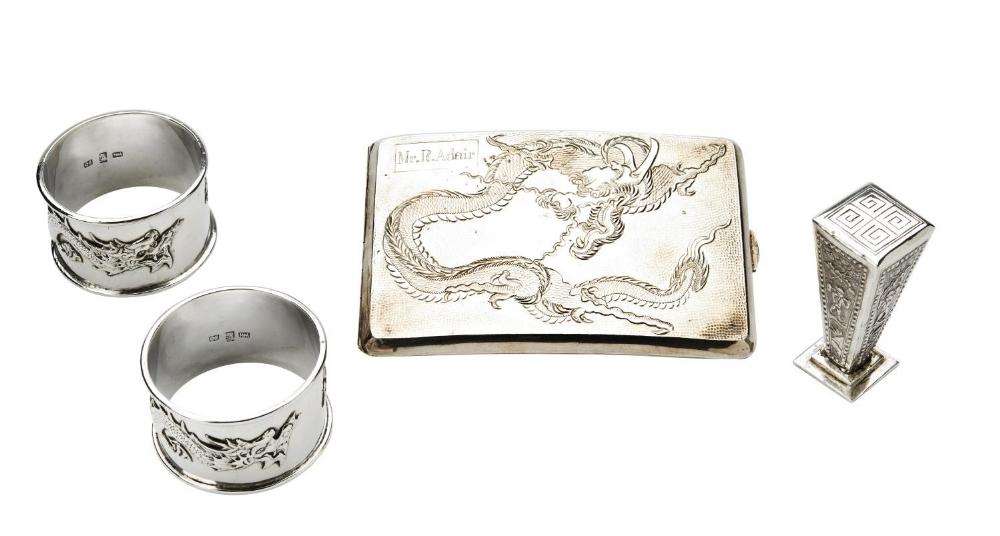 PAIR OF SILVER EXPORT 'DRAGON' NAPKIN RINGS WANG HING, HONG KONG, EARLY 20TH CENTURY together with a