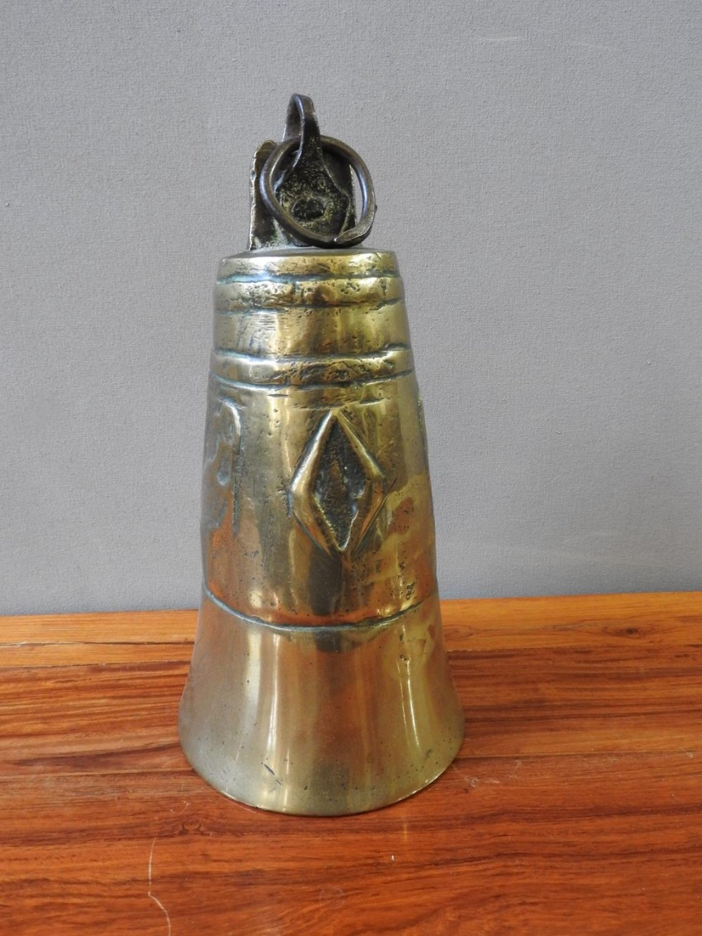 LARGE BRASS BELL 19TH CENTURY 27cm high; together with a SMALL INDIAN BRASS STAMP, 19TH CENTUR