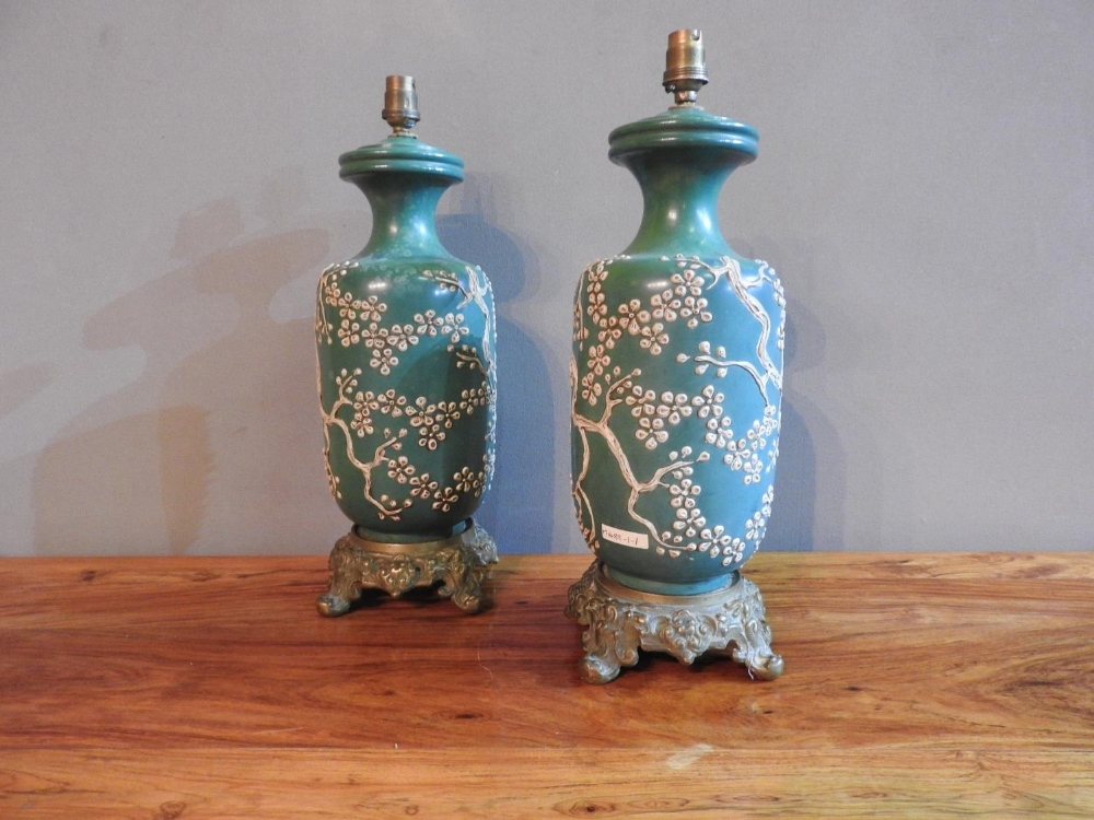 A PAIR OF 19th CENTURY CHINESE GREEN GLAZED TABLE LAMPS EMBOSSED WITH BLOSSOM PATTERN ON ORNATE BRAS - Image 2 of 3