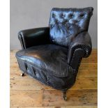 VINTAGE DISTRESSED BLACK LEATHER BUTTON BACK TUB CHAIR ON TURNED FRONT LEGS AND CASTORS (92cm wide,
