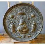 LARGE INDIAN BRASS CHARGER 19TH CENTURY decorated in relief with Ganesha 92cm diam
