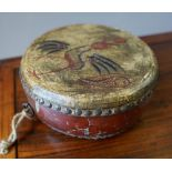 TOBETAN PAINTED HIDE HAND DRUM EARLY 20TH CENTURY 25cm diam; together with a PAIR OF BRASS CANDLESTI