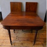 GEORGIAN MAHOGANY D-END DINING TABLE WITH TWO LEAVES, on turned tapered legs terminating in brass ca