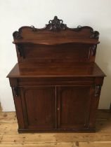 VICTORIAN MAHOGANY CHIFFONIER WITH TWO PANELLED DOORS,single drawer and carved serpentine back panel