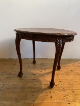 CARVED HONGMU OVAL TABLE LATE QING DYNASTY the shaped top above a foliate carved frieze, supported