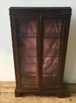 Walnut glazed two-door display cabinet with three shelves Height 105cm, width 59cm, depth 29cm