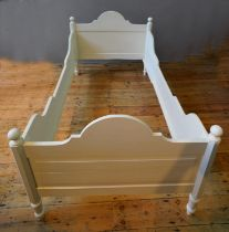 CREAM PAINTED PANELLED SINGLE BED STEAD WITH BALL FINIALS, SHAPED SIDE RAILS AND SLATS (113cm
