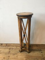 STAINED BEECHWOOD JARDINIERE STAND 20TH CENTURY in the manner of Thomas Hope 101cm high, 35cm diam
