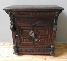 ORNATE 19th CENTURY CONTINENTAL OAK CARVED GOTHIC SIDE CUPBOARD, WITH HERALDIC DETAILING (99cm wide,