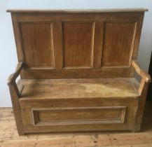 19th CENTURY WAXED PINE PANELLED SETTLE, with lift top seat with storage below 136 x 150 x 53cm