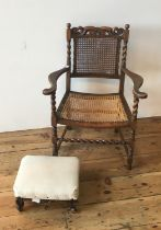 CARVED OAK CANE SEAT CHILD'S ELBOW CHAIR WITH BARLEY TWIST STRETCHER BAR AND PILLARS SUPPORTING