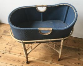 VINTAGE BLUE PAINTED LOOM COT ON RATTAN STAND, with 4 casters 78 x 43 x 83cms
