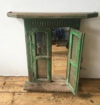 MIRROR PANEL IN DISTRESSED GREEN PAINTED WOODEN FRAME, protected with a pair of fret work panelled