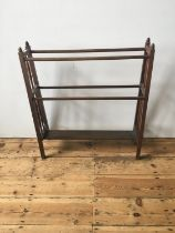 LATE VICTORIAN MAHOGANY TAPERED TOWEL RAIL, with turned spindle supports and finials 85cm high x